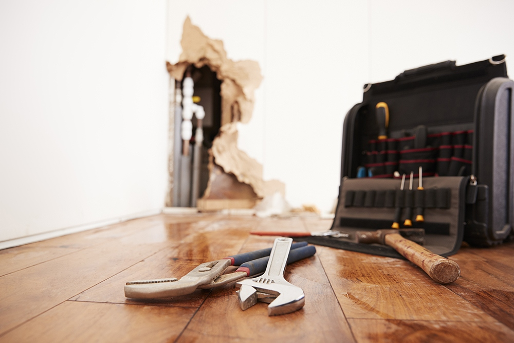 tools lying on a damaged floor