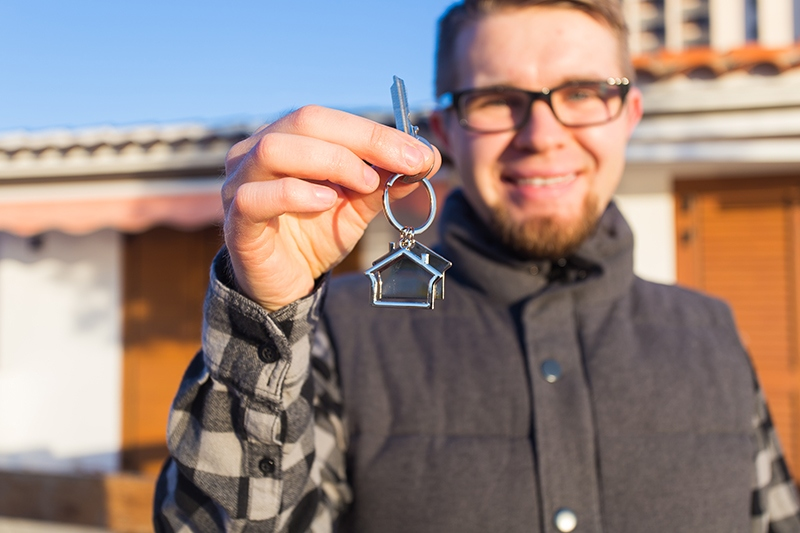 man holding key to new home