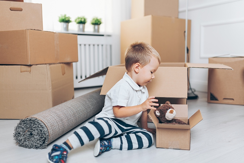 toddler on floor with moving boxes